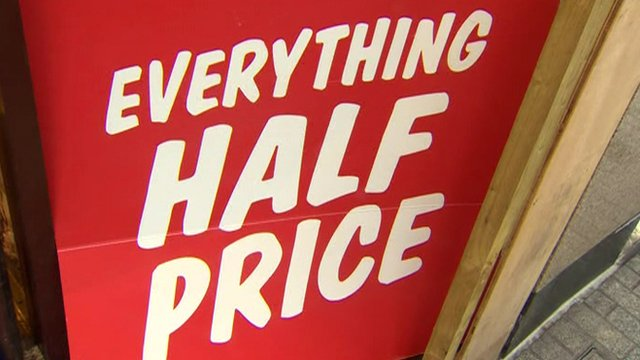 Sign reading : Everything Half Price