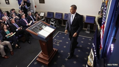 "U.S. President Barack Obama arrives at the lectern to deliver remarks after the House of Representatives acted on legislation intended to avoid the ""fiscal cliff"""