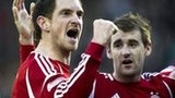 Scott Vernon and Nial McGinn celebrate for Aberdeen