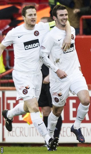 Jon Daly and Gavin Gunning celebrate for United at Pittodrie
