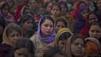 Indian women offer prayers for a gang rape victim at Mahatma Gandhi memorial in Delhi, India, 2 January