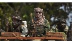 Three Chadian soldiers on a truck as they make their way towards the town of Damara in the Central African Republic