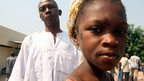 Mariame Kanfando and her father wait outside the morgue in in Abidjan, Ivory Coast, 2 January