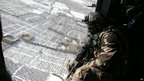 A French gunner sits in a military helicopter flying above Kabul, 1 January  