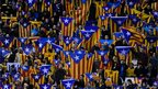 Catalan nationalists hold flags as they watch Catalonia play a friendly against Nigeria in Barcelona, 2 January