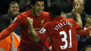 Luis Suarez (left) and Raheem Sterling