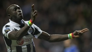 Papiss Cisse celebrates scoring for Newcastle