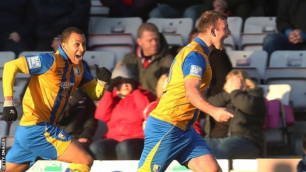 Matt Rhead (right) celebrates his crucial last-gasp equaliser against Lincoln in this season's FA Cup