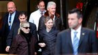 US Secretary of State Hillary Clinton (left) leaves New York Presbyterian Hospital with husband, Bill and daughter Chelsea