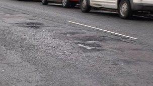 Pot holes in road