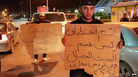 Libyan policemen in civilian clothing protest against the kidnapping of the Head of Criminal Investigation Department, Abdel Salam al-Mahdawi, outside the Tibesti hotel in Benghazi, on January 3, 2013.