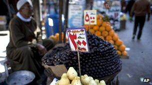An Egyptian street vendor displays fruits