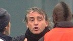 Mario Balotelli (far right) and Roberto Mancini (second right)