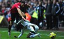 Manchester United substitute Ryan Giggs attempts to evade the tackle of Swansea Citys Nathan Dyer in a game which ended 1-1 at the Liberty Stadium.