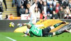 Wayne Routledge steers the ball past Brad Guzan to give Swansea City the lead again Aston Villa at the Liberty Stadium.