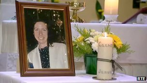 Photo of Catherine Gowing and candle inside funeral church