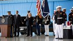US President Barack Obama takes the hand of Secretary of State Hillary Clinton as the bodies of four Americans killed in an attack on the consulate in Benghazi, Libya, return to the US at Joint Base Andrews, Maryland 14 September 2012