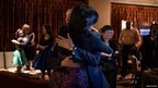 US President Barack Obama hugs the first lady as US networks project that he has been re-elected Chicago, Illinois 6 November 2012
