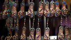 Earrings with the image of Venezuelan President Hugo Chavez are displayed at a store in Caracas