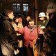 Yuan Lihai (centre), the owner of a private orphanage, talks to rescuers and inspectors