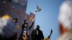 A Palestinian marks the 48th anniversary of the founding of the Fatah party, Gaza, 4 January