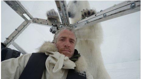 Gordon Buchanan and polar bear inside Ice Cube
