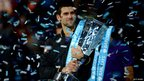 Novak Djokovic of Serbia lifts the trophy as he celebrates victory after his men's singles final match against Roger Federer of Switzerland during day eight of the ATP World Tour Finals at O2 Arena on 12 November 2012