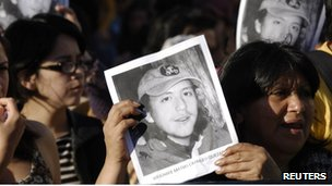 Protesters hold up posters of Matias Catrileo at a rally in Santiago on 4 January 2012