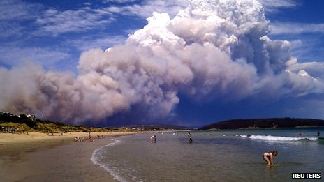 Wildfire smoke billows over a beach east of Hobart, Tasmania, 4 January 2013