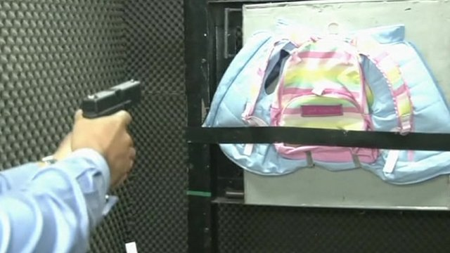 Gun pointed towards a bullet-proof vest