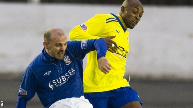 Cowdenbeath's Colin Cameron tussles with Morton's Fouad Bachirou