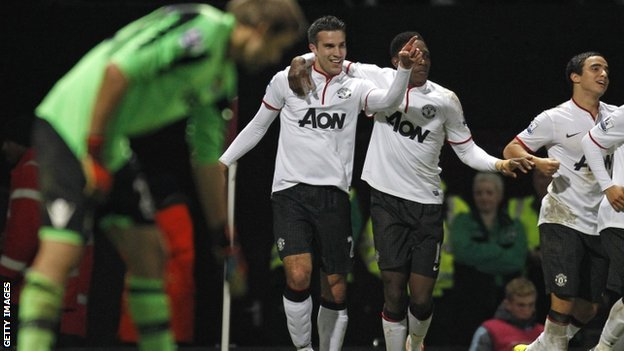 Robin van Persie (centre) celebrates