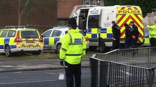 Police officers at the scene of the shooting