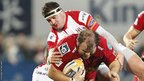 Jacobie Adriaanse is tackled as the Scarlets take on Ulster in the Pro12