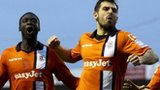 Luton players celebrate scoring the opening goal against Wolves