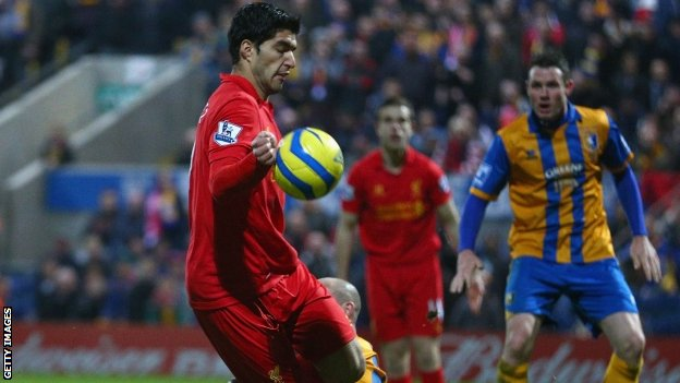 Luis Suarez scores Liverpool's second