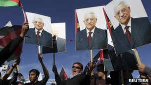 Archive photo of Palestinians holding placards of Mahmoud Abbas, 2 December 2012