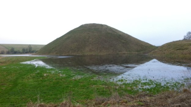 Floodwater surrounds Silbury Hill in Wiltshire