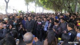 Demonstrators gather along a street near the headquarters of Southern Weekly newspaper in Guangzhou, Guangdong province, 7 January 2013.
