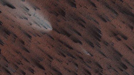 Image of Martian surface showing fan-shaped deposits
