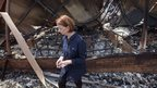 Australian Prime Minister Julia Gillard inspects the burnt remains of the Dunally school in south-east Tasmania on 7/1/13