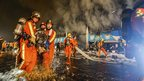 Firefighters at a market fire in Shanghai, China, on 6/1/13
