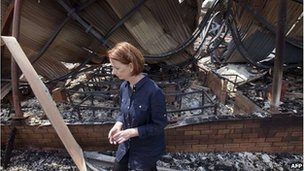 Julia Gillard visits a burnt-out school in Tasmania on Monday