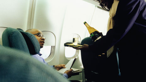 Passenger being served wine