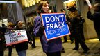Anti fracking protesters demonstrate in front of the Waldorf Astoria in New York