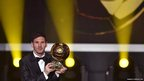 Barcelona and Argentina forward Lionel Messi with the Ballon d'Or trophy