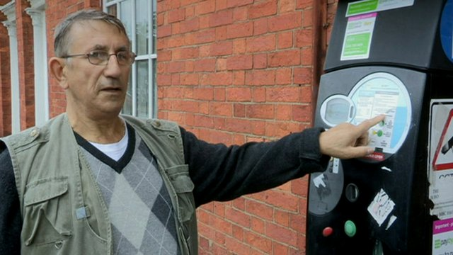 Barry Moss from Bolton next to a pay and display machine