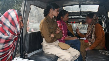 Rukhsana (right) being questioned by police after being rescued 