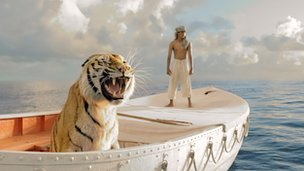 Suraj Sharma with 'Richard Parker' in Life of Pi