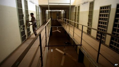 An Iraqi army soldier closes the door of a cell in Abu Ghraib prison 2 September 2006